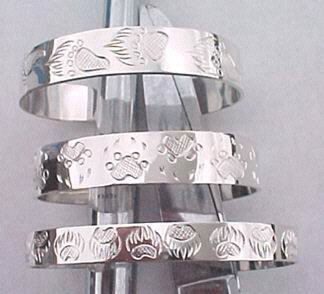 "Silver Bracelets - BS21 - Size samples, 3/8"", 1/2"" and 5/8"", Grizzly at top, Wolfpaw and bearclaws"