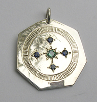 Medicine Wheel Pendants -MdP6j with 2mm sapphires and a 2.5mm evergreen topaz on a 7 aside silver pendant