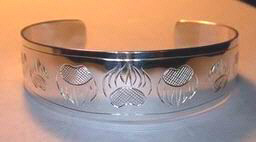 "Silver Bracelets - BS4d - 5/8"" with staight band and BS4e with tapered ends and paws"