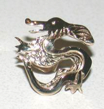 Non-Native Earrings dragon studs in gold and silver
