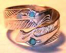RbfSt1f - Double Eage Wrap around ring with a 2mm Turquoise eye