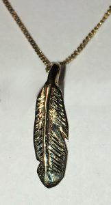 "cast 14k yellow gold feather- 1"" X .25"""