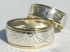 Appliquéd Rings - Rap27 - Sunburst, feather and wolfpaw with gold ribs
