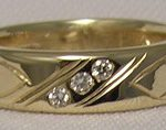 Wedding Rings - ChSt1e - 8mm wide band with feathers and 3-.03ct diamonds