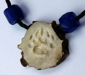 Round Pendants - Pen27 - grizzly paw carved into deer horn with cord