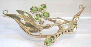 Hummingbird Pendant and Barrette in gold with peridots, sapphires, diamonds