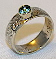 Wedding Rings - MdSt38 2 feathers with 5mm Aquamarine in 14k yellow gold
