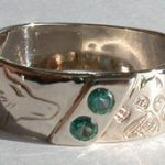 Wedding Rings - ChSt15 - Channel set Green garnets with Wolfhead and paw