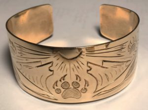 BG10 - Our first gold bracelet,1989- Howling Wolves feathers bearclaws and sun burst