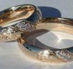Wedding Rings - ChSt18a and b - Wolfpaws on 5mm thin band by 2mm thick