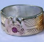 Wedding Rings - RbfSt24a - Wolfpaw, feather and Ruby