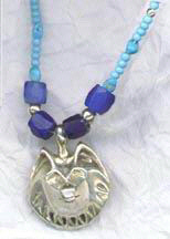 Cast Pendants - PenC21 - Wolf head and turquoise chain and west coast trade beads