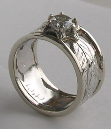 Platinum Rings - PlrSt10 - Cut-out leaves with ribs in Platinum with .82ct diamond